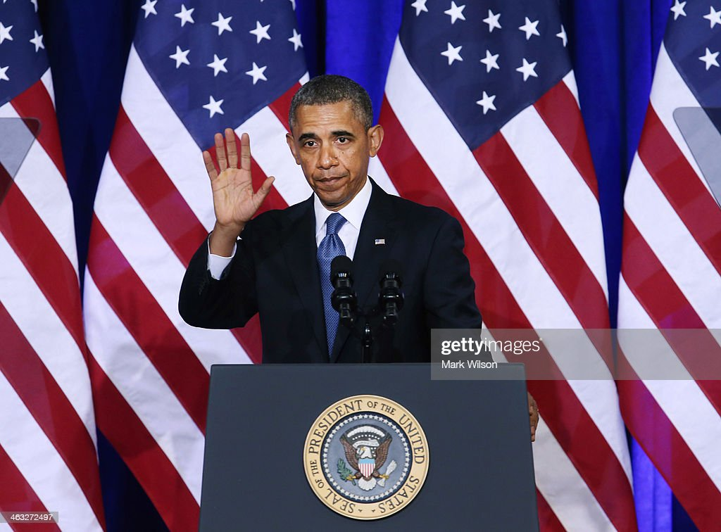 U.S. President <a gi-track='captionPersonalityLinkClicked' href=/galleries/search?phrase=Barack+Obama&family=editorial&specificpeople=203260 ng-click='$event.stopPropagation()'>Barack Obama</a> waves after speaking about the National Security Agency (NSA) at the Justice Department, on January 17, 2014 in Washington, DC. President Obama outlined new changes to the agency's most controversial surveillance practices.