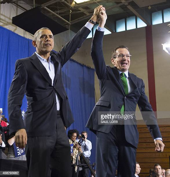 US President Barack Obama waves after speaking at a campaign rally for Democratic Governor Dan Malloy who is up for reelection at Central High School...