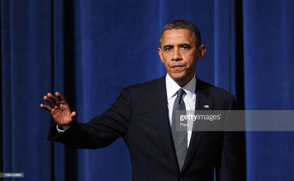 U.S. President <a gi-track='captionPersonalityLinkClicked' href=/galleries/search?phrase=Barack+Obama&family=editorial&specificpeople=203260 ng-click='$event.stopPropagation()'>Barack Obama</a> waves after speaking at an interfaith vigil for the shooting victims from Sandy Hook Elementary School on December 16, 2012 at Newtown High School in Newtown, Connecticut. Twenty-six people were shot dead, including twenty children, after a gunman identified as Adam Lanza opened fire at Sandy Hook Elementary School. Lanza also reportedly had committed suicide at the scene. A 28th person, believed to be Nancy Lanza, found dead in a house in town, was also believed to have been shot by Adam Lanza.