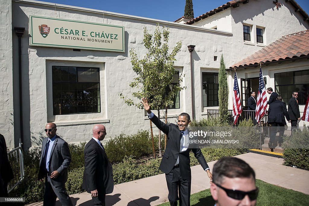 US President Barack Obama waves after speaking at the establishment of the Chavez National Monument October 8, 2012 in Keene, California. Obama is on a three day trip where he will campaign in California and Ohio as well as attend the establishment of the Cesar E. Chavez National Monument. AFP PHOTO/Brendan SMIALOWSKI