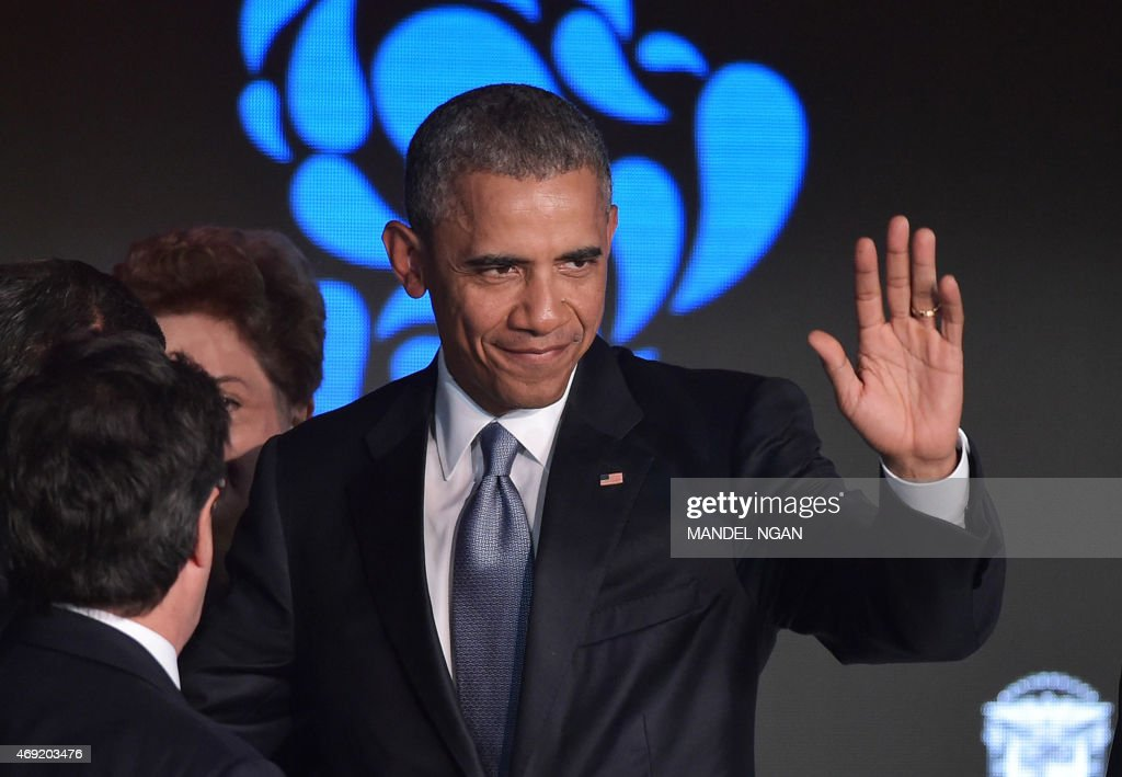 US President <a gi-track='captionPersonalityLinkClicked' href=/galleries/search?phrase=Barack+Obama&family=editorial&specificpeople=203260 ng-click='$event.stopPropagation()'>Barack Obama</a> waves after taking part in the CEO Summit of the Americas at a hotel in Panama City on April 10, 2015. Regional leaders are gathering in a historic Summit of the Americas that will see the US and Cuban presidents sit face to face for the first time in decades. AFP PHOTO / MANDEL NGAN