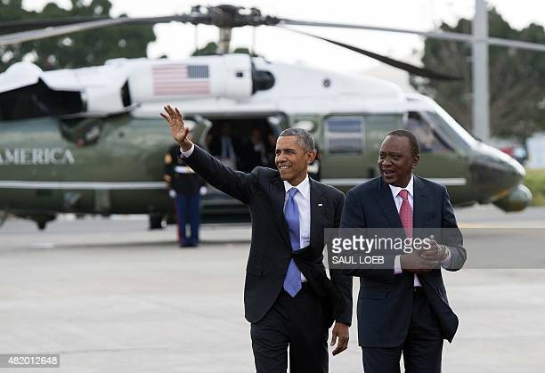 US President Barack Obama waves alongside his Kenyan counterpart Uhuru Kenyatta before boarding Air Force One prior to his departure from Kenyatta...