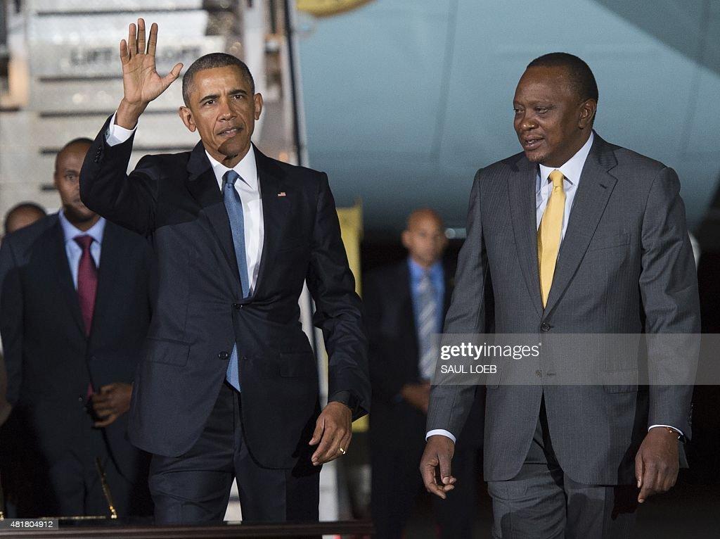 US President Barack Obama waves alongside Kenyan President Uhuru Kenyatta upon arrival on Air Force One at Kenyatta International Airport in Nairobi...