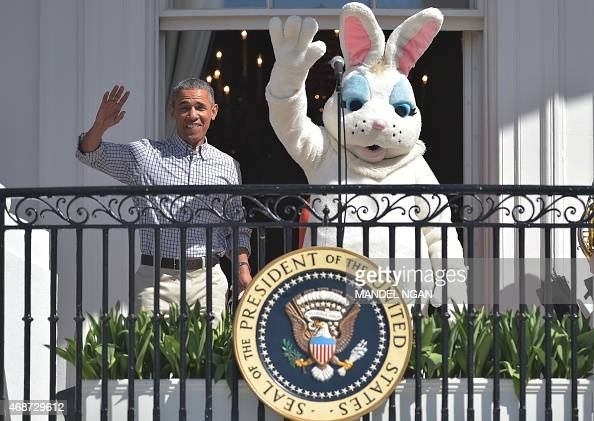 US President Barack Obama waves alongside the 'Easter Bunny' during the annual Easter egg roll on the South Lawn of the White House on April 6 2015...