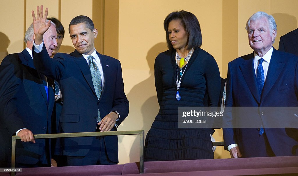 US President <a gi-track='captionPersonalityLinkClicked' href=/galleries/search?phrase=Barack+Obama&family=editorial&specificpeople=203260 ng-click='$event.stopPropagation()'>Barack Obama</a> waves alongside US Vice President Joe Biden (L), First Lady <a gi-track='captionPersonalityLinkClicked' href=/galleries/search?phrase=Michelle+Obama&family=editorial&specificpeople=2528864 ng-click='$event.stopPropagation()'>Michelle Obama</a> (2nd R) and Massachusetts Senator Ted Kennedy during a musical birthday salute to Kennedy at the Kennedy Center in Washington, DC, March 8, 2009. AFP PHOTO / Saul LOEB