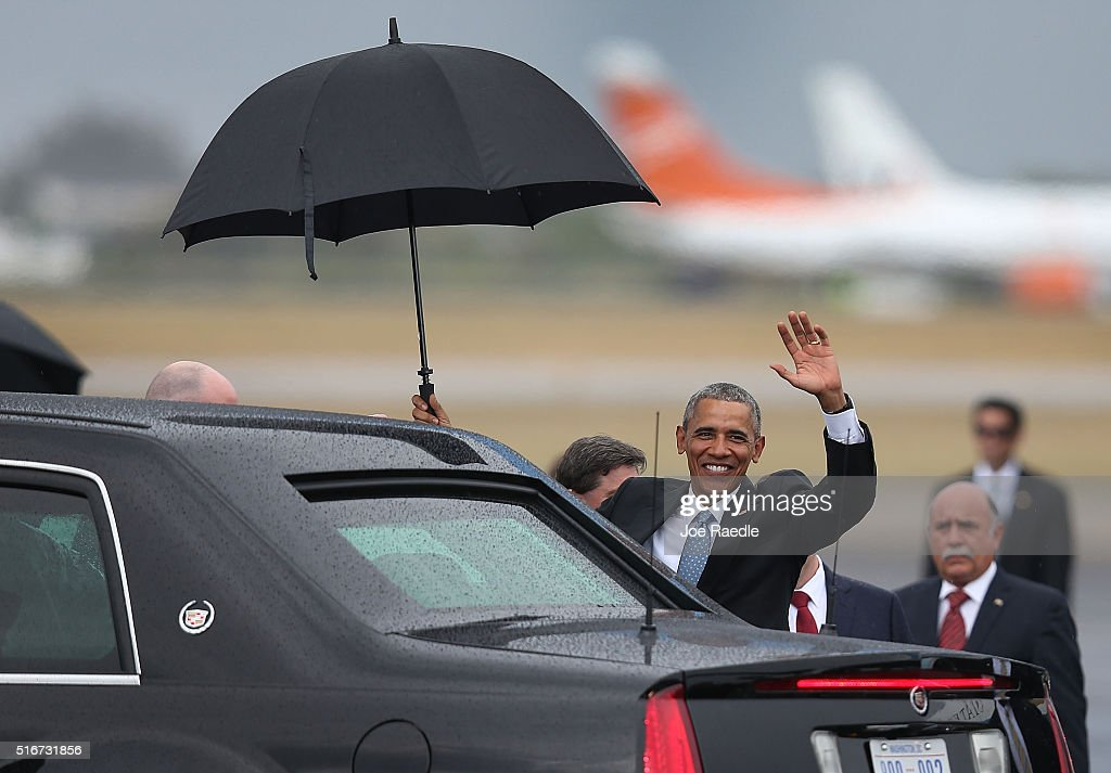 President <a gi-track='captionPersonalityLinkClicked' href=/galleries/search?phrase=Barack+Obama&family=editorial&specificpeople=203260 ng-click='$event.stopPropagation()'>Barack Obama</a> waves as he arrives at Jose Marti International Airport on Air Force One for a 48-hour visit on March 20, 2016 in Havana, Cuba. Mr. Obama's visit is the first in nearly 90 years for a sitting president, the last one being Calvin Coolidge.