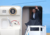 S President Barack Obama waves as he arrives at Jose Marti International Airport on Airforce One for a 48hour visit on March 20 2016 in Havana Cuba...