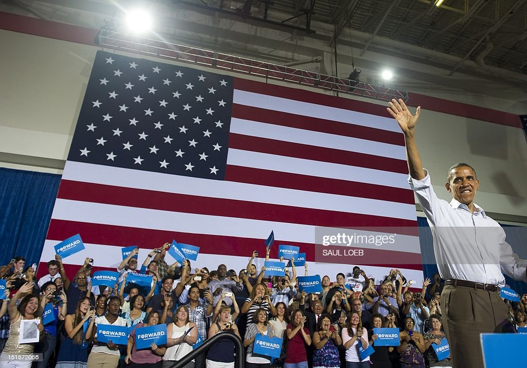 US President Barack Obama waves as he arrives for a campaign event at Kissimmee Civic Center in Kissimmee Florida September 8 during the first day of...