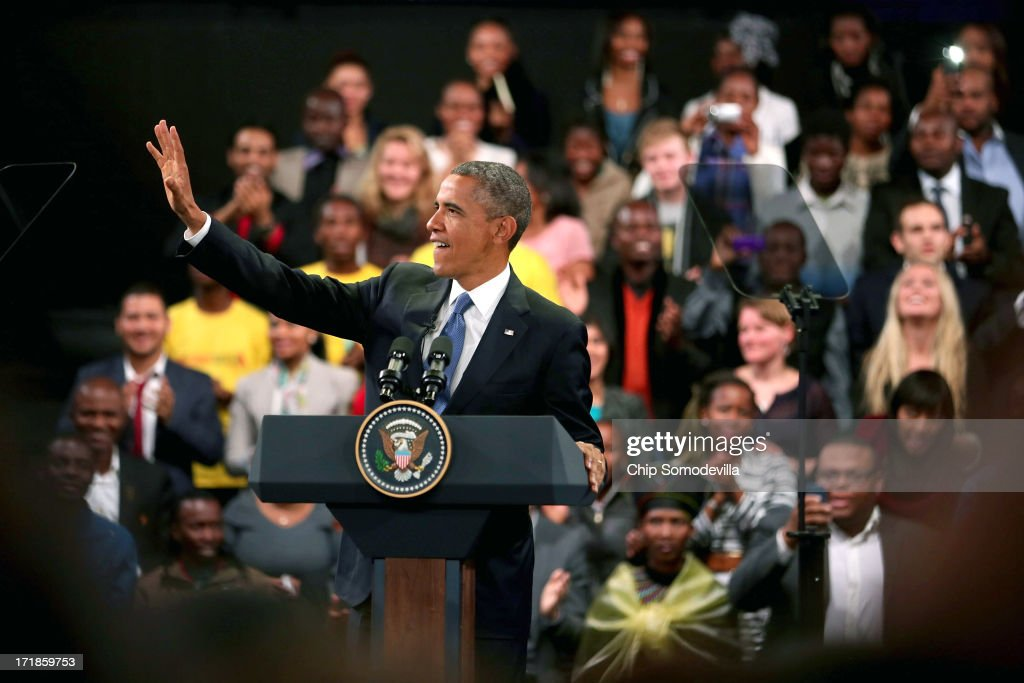 U.S. President <a gi-track='captionPersonalityLinkClicked' href=/galleries/search?phrase=Barack+Obama&family=editorial&specificpeople=203260 ng-click='$event.stopPropagation()'>Barack Obama</a> waves as he arrives for a 'town hall' meeting with the young African leaders at the University of Johannesburg in Soweto June 29, 2013 in Johannesburg, South Africa. South Africa is the second leg of Obama's three-country tour of the African continent, which includes Senegal and Tanzania.