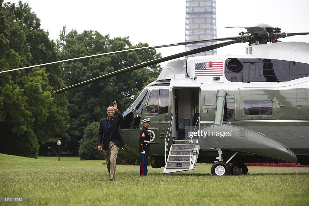 U.S. President <a gi-track='captionPersonalityLinkClicked' href=/galleries/search?phrase=Barack+Obama&family=editorial&specificpeople=203260 ng-click='$event.stopPropagation()'>Barack Obama</a> waves as he arrives on the South Lawn of the White House on June 9, 2013 in Washington, DC. Obama is returning from a summit in southern California with Chinese President Xi Jinping.