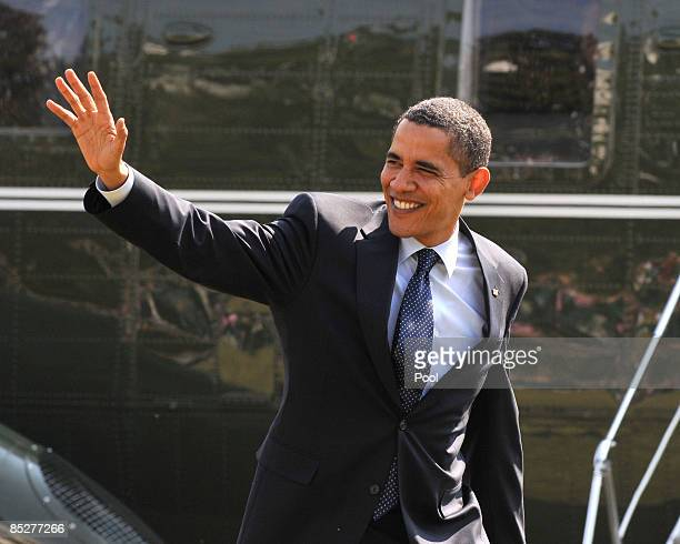 US President Barack Obama waves as he arrives on the South Lawn of the White House March 6 2009 in Washington DC Obama was returning after making...