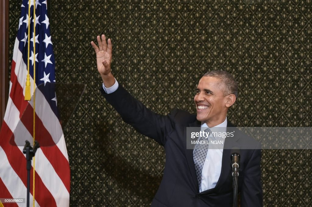 US President Barack Obama waves as he arrives to address the Illinois General Assembly at the Illinois State Capitol in Springfield Illinois on...