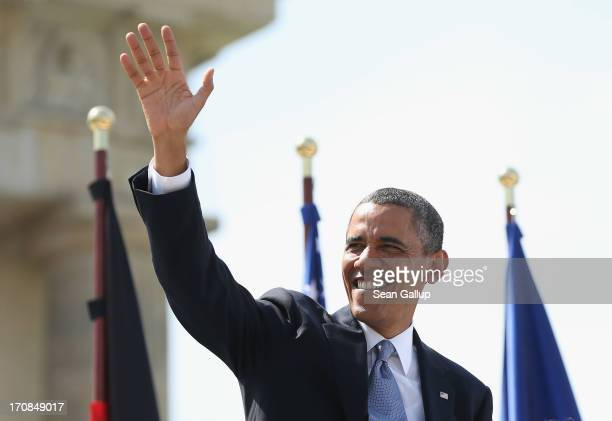 S President Barack Obama waves as he arrives to speak at the Brandenburg Gate on June 19 2013 in Berlin Germany Obama is visiting Berlin for the...