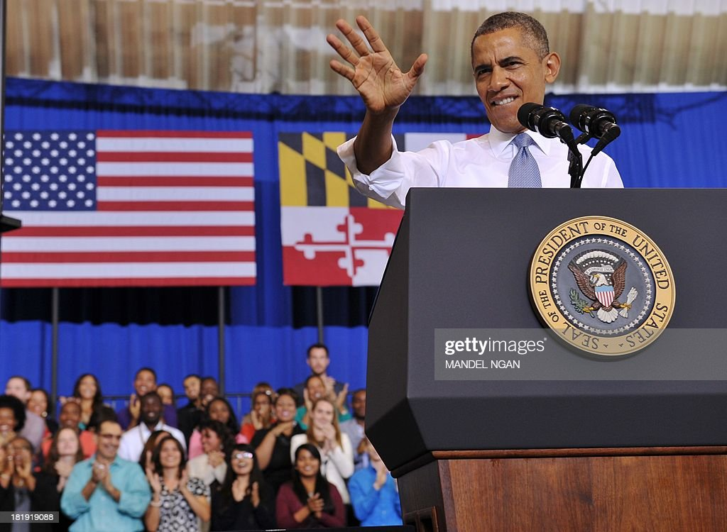 US President Barack Obama waves as he arrrives on stage to speak about the Affordable Care Act at Prince Georges Community College on September 26, 2013 in Largo, Maryland. On October 1, 2013, open enrollment starts for the new Obamacare online, state-based exchanges, where consumers will be able to compare and shop for private health insurance plans. AFP PHOTO/Mandel NGAN