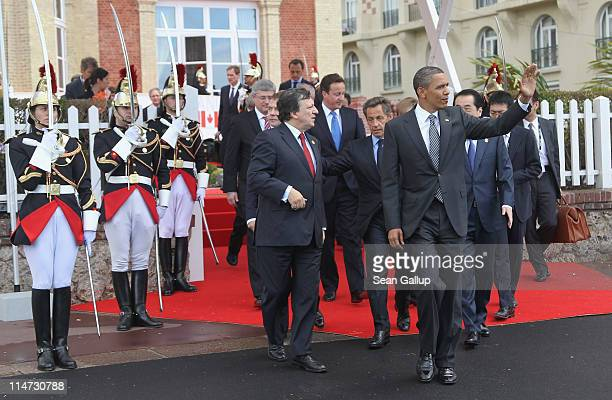 S President Barack Obama waves as he emerges with President of the European Commission Jose Manuel Barroso British Prime Minister David Cameron...