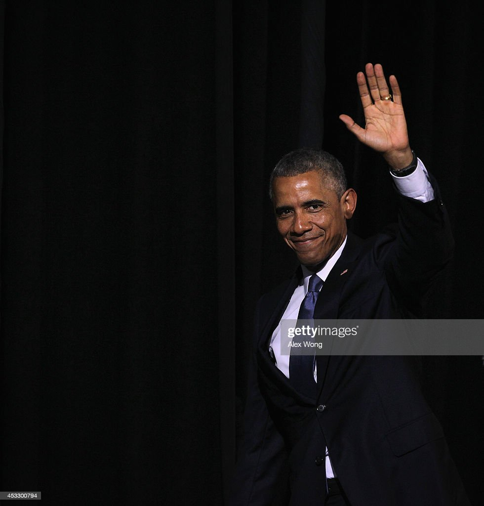 U.S. President <a gi-track='captionPersonalityLinkClicked' href=/galleries/search?phrase=Barack+Obama&family=editorial&specificpeople=203260 ng-click='$event.stopPropagation()'>Barack Obama</a> waves as he leaves after a signing ceremony of H.R. 3230 August 7, 2014 at Wallace Theater in Fort Belvoir, Virginia. President Obama has signed the Veterans' Access to Care through Choice, Accountability, and Transparency Act of 2014 into law.