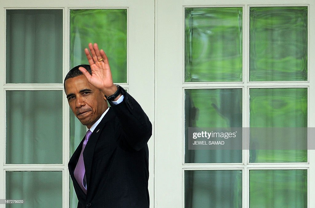 US President Barack Obama waves as he leaves after attending a ceremony to honor 2013 National Teacher and States Teachers of the Year at the Rose Garden of the White House in Washington on April 23, 2013. AFP PHOTO/Jewel Samad