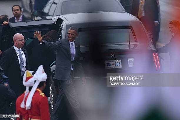 US President Barack Obama waves as he leaves India's Republic Day parade on Rajpath in New Delhi on January 26 2015 Rain failed to dampen spirits at...