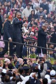 US President Barack Obama waves as he leaves India's Republic Day parade on Rajpath with Indian Prime Minister Narendra Modi and Indian President...