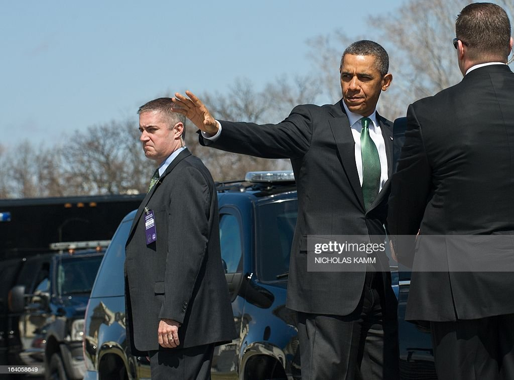 US President <a gi-track='captionPersonalityLinkClicked' href=/galleries/search?phrase=Barack+Obama&family=editorial&specificpeople=203260 ng-click='$event.stopPropagation()'>Barack Obama</a> waves as he leaves the US Capitol after the Friends of Ireland luncheon in Washington on March 19, 2013. AFP PHOTO/Nicholas KAMM