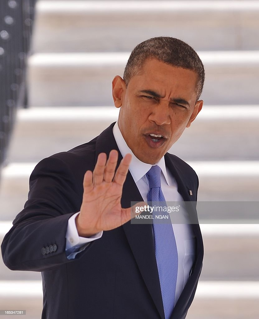 US President <a gi-track='captionPersonalityLinkClicked' href=/galleries/search?phrase=Barack+Obama&family=editorial&specificpeople=203260 ng-click='$event.stopPropagation()'>Barack Obama</a> waves as he makes his to board Marine One April 3,2013 on the South Lawn of the White House in Washington, DC. Obama was headed for visits to Colorado and California. AFP PHOTO/Mandel NGAN