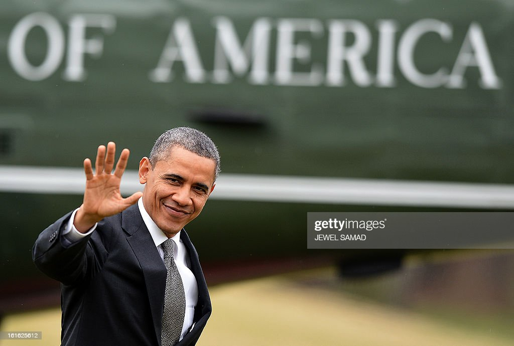 US President Barack Obama waves as he returns at the White House in Washington, DC, on February 13, 2013. A day after vowing to ignite America's economic engine, Obama hit the factory floor Wednesday, to promise a rebound in job-creating manufacturing industry. AFP PHOTO/Jewel Samad