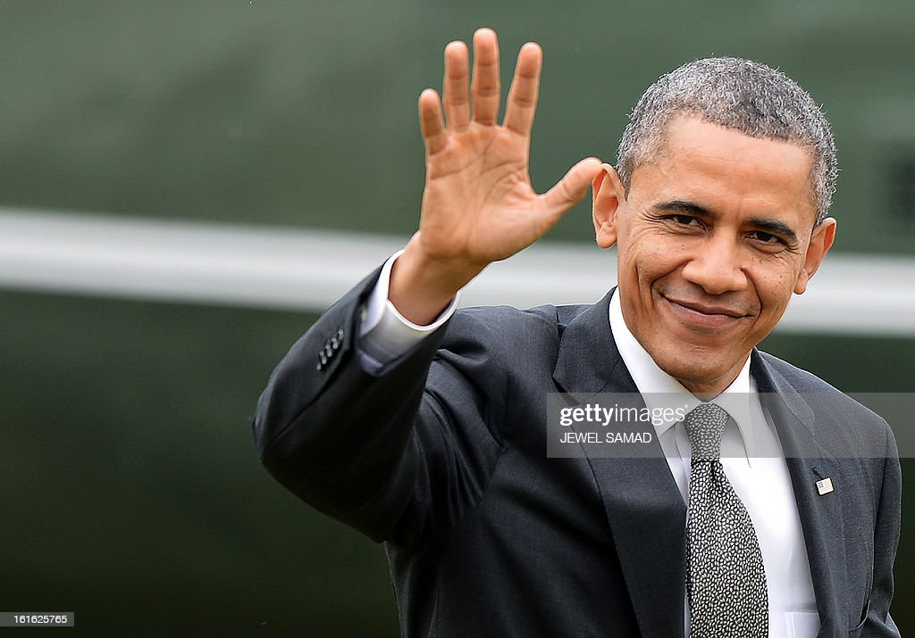 US President Barack Obama waves as he returns to the White House in Washington, DC, on February 13, 2013. A day after vowing to ignite America's economic engine, Obama hit the factory floor Wednesday, to promise a rebound in job-creating manufacturing industry. AFP PHOTO/Jewel Samad