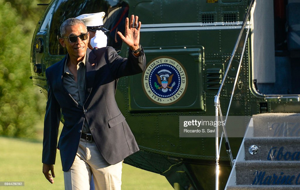 President Barack Obama waves as he steps off Marine One after returning to the White House from Baton Rouge Louisiana on August 23 2016 in Washington...