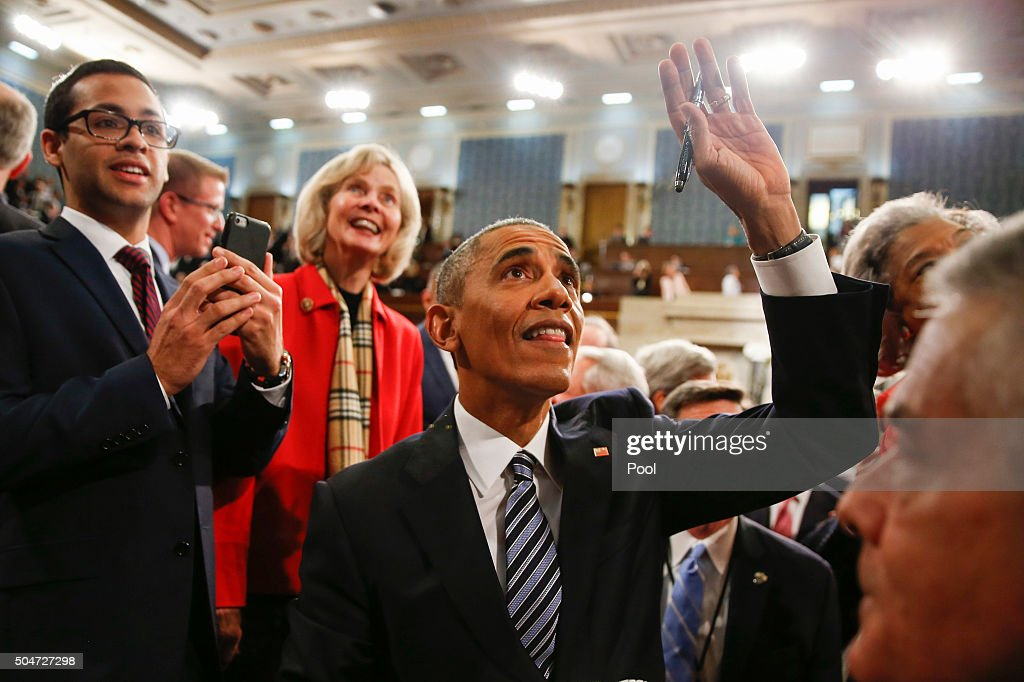 President Barack Obama waves as he walks back up the aisle at conclusion of his State of the Union address to a joint session of Congress on Capitol Hill January 12, 2016 in Washington, D.C. In his final State of the Union, President Obama reflected on the past seven years in office and spoke on topics including climate change, gun control, immigration and income inequality.