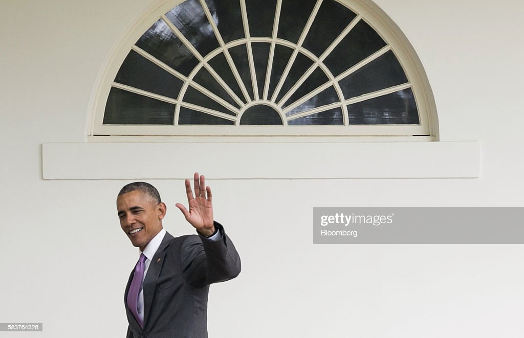 us president barack obama waves as he walks down the colonnade to the oval office at barack obama enters oval