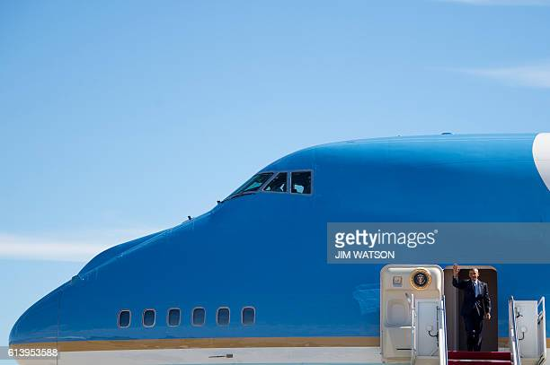 President Barack Obama waves as he walks off Air Force One in Greensboro North Carolina October 11 2016 President Obama is in Greensboro to...