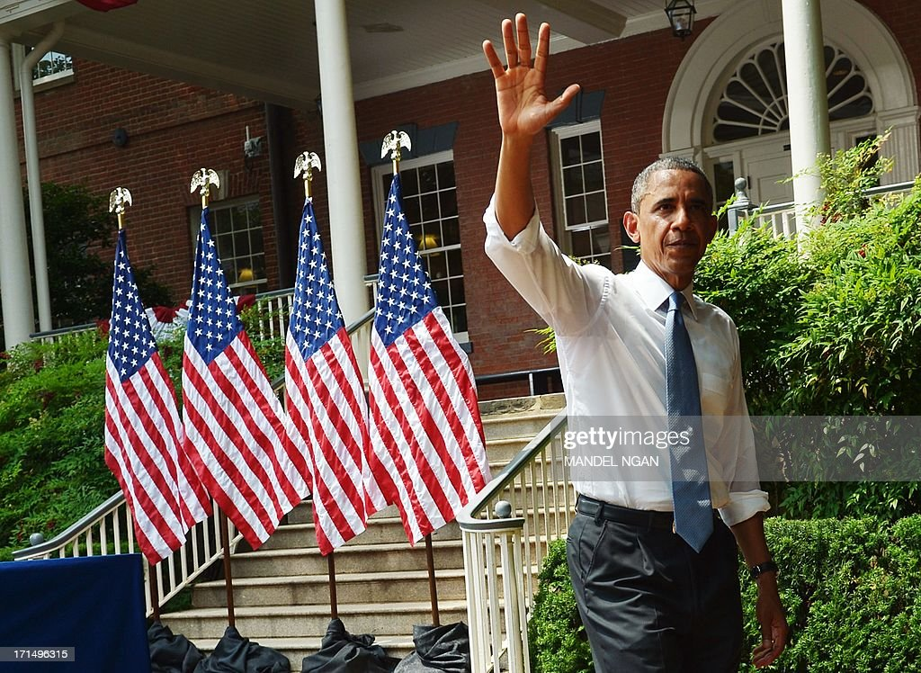 US President <a gi-track='captionPersonalityLinkClicked' href=/galleries/search?phrase=Barack+Obama&family=editorial&specificpeople=203260 ng-click='$event.stopPropagation()'>Barack Obama</a> waves as he walks off stage after speaking on climate change on June 25, 2013 at Georgetown University in Washington, DC. AFP PHOTO/Mandel NGAN
