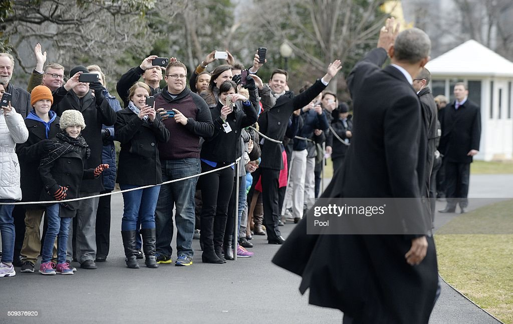 U.S. President Barack Obama waves as he walks out of the residence toward Marine One while departing the White House, on February 10, 2016 in Washington, DC. President Obama is traveling to Springfield, Illinois where he will address the Illinois General Assembly.