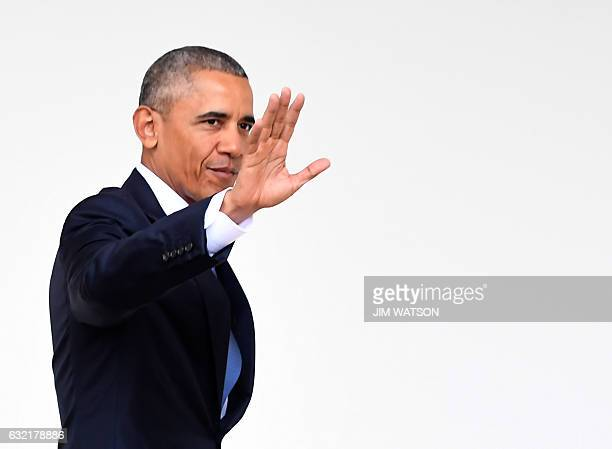 US President Barack Obama waves as he walks through the colonnade as he departs the Oval Office for the last time as president at the White House in...