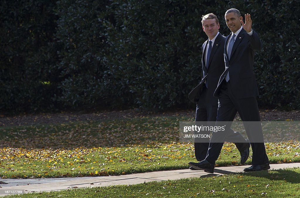 US President <a gi-track='captionPersonalityLinkClicked' href=/galleries/search?phrase=Barack+Obama&family=editorial&specificpeople=203260 ng-click='$event.stopPropagation()'>Barack Obama</a> (R) waves as he walks to Marine One with Chairman of the Democratic Senatorial Campaign Committee US Senator Michael Bennet, D-Colorado, at the White House in Washington, DC, November 6, 2013. AFP PHOTO / Jim WATSON
