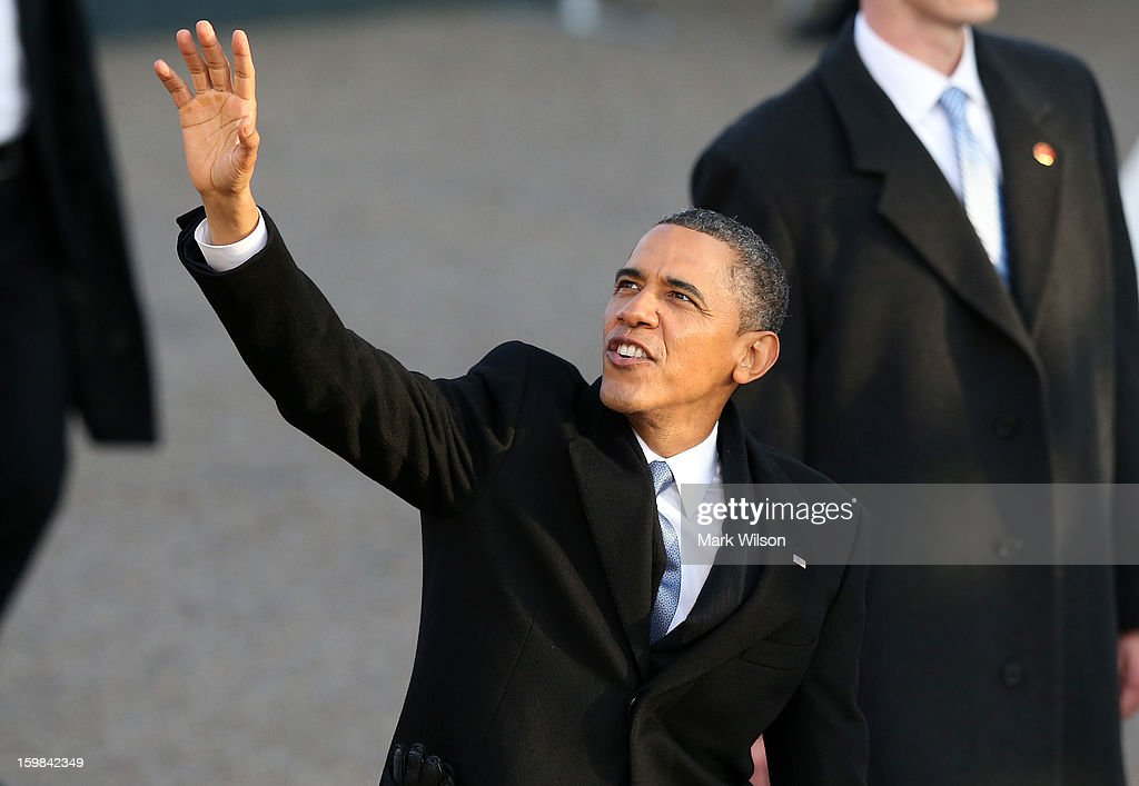 U.S. President Barack Obama waves as the presidential inaugural parade winds through the nation's capital January 21, 2013 in Washington, DC. Barack Obama was re-elected for a second term as President of the United States.