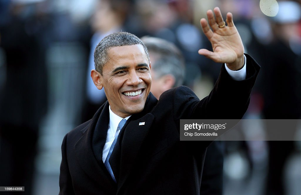 U.S. President <a gi-track='captionPersonalityLinkClicked' href=/galleries/search?phrase=Barack+Obama&family=editorial&specificpeople=203260 ng-click='$event.stopPropagation()'>Barack Obama</a> waves as the presidential inaugural parade winds through the nation's capital January 21, 2013 in Washington, DC. <a gi-track='captionPersonalityLinkClicked' href=/galleries/search?phrase=Barack+Obama&family=editorial&specificpeople=203260 ng-click='$event.stopPropagation()'>Barack Obama</a> was re-elected for a second term as President of the United States.