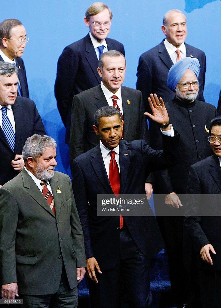 S President Barack Obama waves at the conclusion of a group photo opportunity at the Lawrence Convention Center site of the G20 summit as Brazilian...