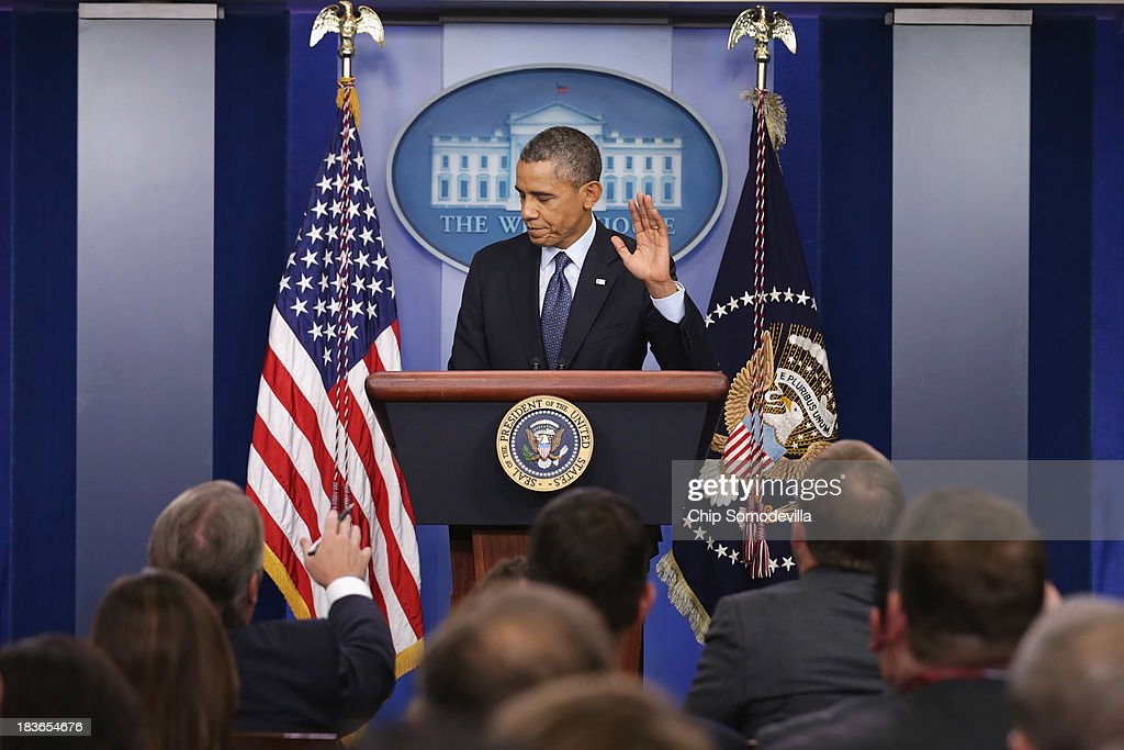 U.S. President <a gi-track='captionPersonalityLinkClicked' href=/galleries/search?phrase=Barack+Obama&family=editorial&specificpeople=203260 ng-click='$event.stopPropagation()'>Barack Obama</a> waves at the conclusion of a press conference in the Brady Press Briefing Room of the White House on October 8, 2013 in Washington, DC. Now in the eighth day of a government shutdown, Obama and his Democratic allies have reiterated to House Speaker John Boehner (R-OH) that they will negotiate but only after Republicans vote to approve a clean extension of government spending and authorize an increase in the debt limit.