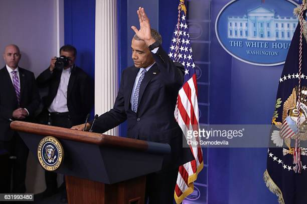 S President Barack Obama waves at the conclusion of the last news conference of his presidency in the Brady Press Briefing Room at the White House...