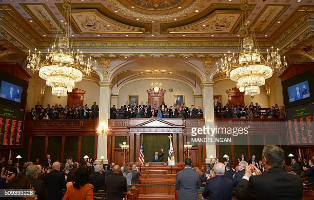 US President Barack Obama waves at the end of his address to the Illinois General Assembly at the Illinois State Capitol in Springfield Illinois on...