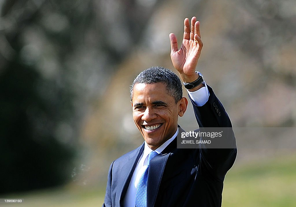 US President <a gi-track='captionPersonalityLinkClicked' href=/galleries/search?phrase=Barack+Obama&family=editorial&specificpeople=203260 ng-click='$event.stopPropagation()'>Barack Obama</a> waves before boarding the Marine One helicopter to leave the White House in Washington, DC, on Febraury 23, 2012 en route to Miami, Florida. AFP Photo/Jewel Samad