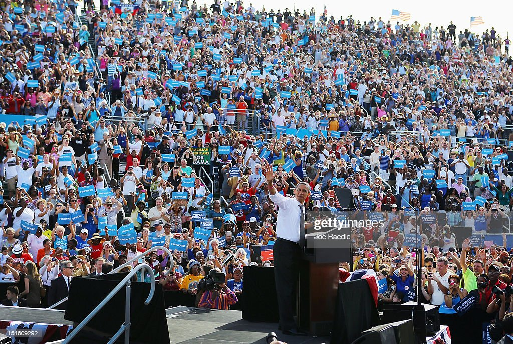 U.S. President <a gi-track='captionPersonalityLinkClicked' href=/galleries/search?phrase=Barack+Obama&family=editorial&specificpeople=203260 ng-click='$event.stopPropagation()'>Barack Obama</a> waves during a campaign rally at the Delray Beach Tennis Center on October 23, 2012 in Delray Beach, Florida. Obama continues to campaign across the U.S. in the run-up to the November 6, presidential election.