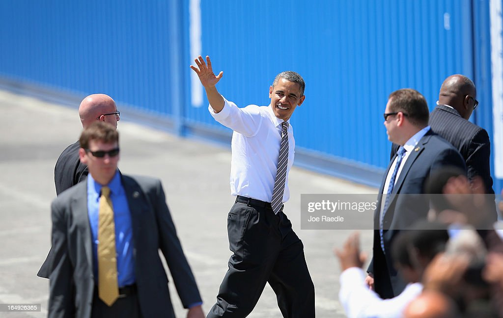President <a gi-track='captionPersonalityLinkClicked' href=/galleries/search?phrase=Barack+Obama&family=editorial&specificpeople=203260 ng-click='$event.stopPropagation()'>Barack Obama</a> (C) waves during an event at PortMiami on March 29, 2013 in Miami, Florida. The president spoke about road and bridge construction during the event at the port in Miami, where he also toured a new tunnel project.
