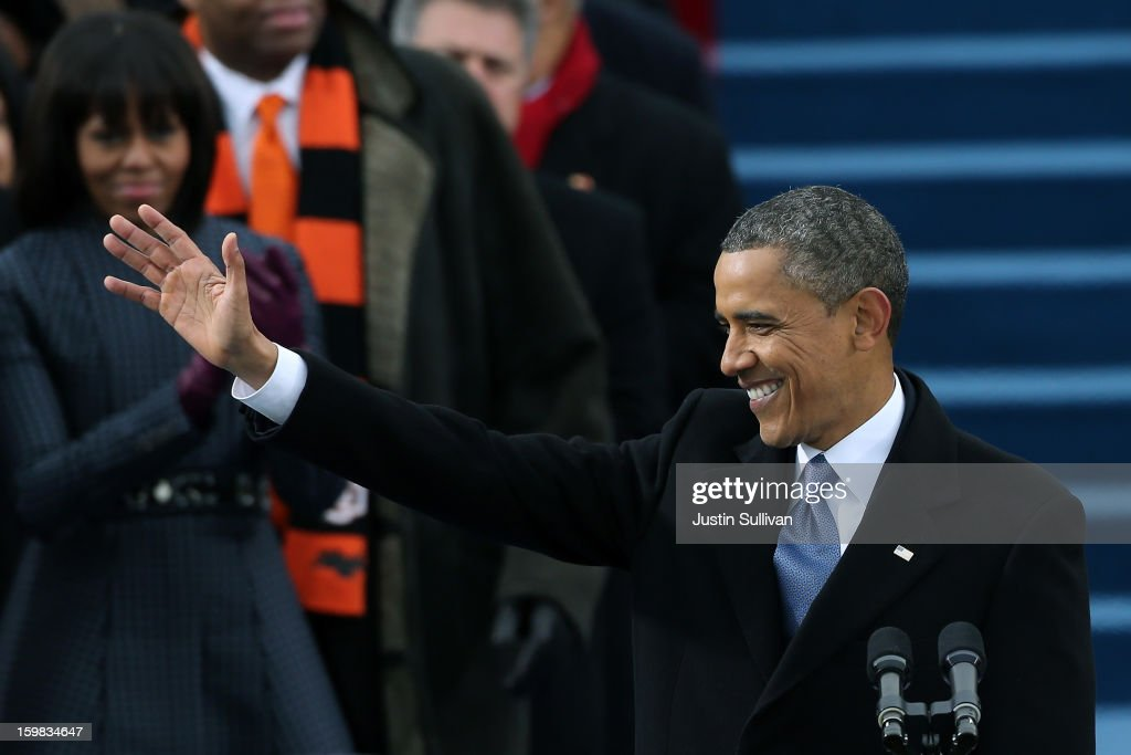 U.S. President Barack Obama waves during the public ceremonial inauguration on the West Front of the U.S. Capitol January 21, 2013 in Washington, DC. Barack Obama was re-elected for a second term as President of the United States.