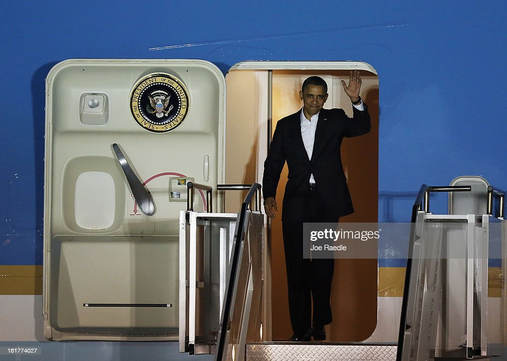 President <a gi-track='captionPersonalityLinkClicked' href=/galleries/search?phrase=Barack+Obama&family=editorial&specificpeople=203260 ng-click='$event.stopPropagation()'>Barack Obama</a> waves from Air Force One as he arrives at Palm Beach International Airport on February 15, 2013 in West Palm Beach, Florida. President Obama plans to spend the Presidents Day holiday weekend in the area.