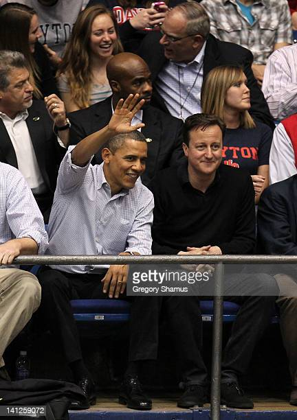 S President Barack Obama waves from his seat as he sits with British Prime Minister David Cameron at UD Arena to watch the Western Kentucky...