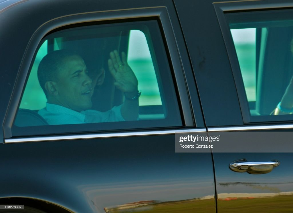 President <a gi-track='captionPersonalityLinkClicked' href=/galleries/search?phrase=Barack+Obama&family=editorial&specificpeople=203260 ng-click='$event.stopPropagation()'>Barack Obama</a> waves from his vehicle after meeting with the crew of the Space Shuttle Endeavour April 29, 2011 in Cape Canaveral, Florida. The Obamas visited the Kennedy Space Center Friday despite the launch delay of the Space Shuttle Endeavour.