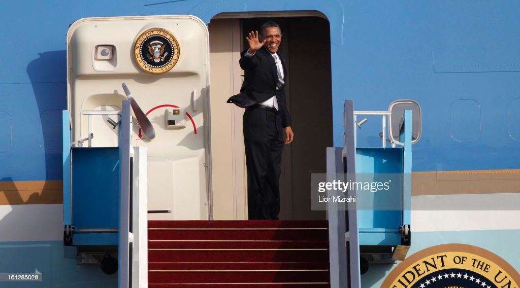 U.S. President Barack Obama waves from the entrance of Air Force One prior to departing from Ben Gurion International Airport on March 22, 2013 in Lod' Israel. Obama concluded his first visit to Israel and West Bank after three-days of meetings with Israeli and Palestinian leaders.