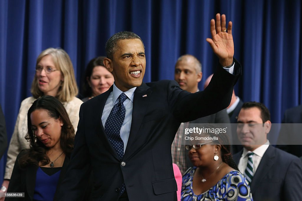 U.S. President <a gi-track='captionPersonalityLinkClicked' href=/galleries/search?phrase=Barack+Obama&family=editorial&specificpeople=203260 ng-click='$event.stopPropagation()'>Barack Obama</a> waves goodbye after delivering remarks about the fiscal cliff negotiations in the Eisenhower Executive Office Building next to the White House December 31, 2012 in Washington, DC. Obama said he was hopeful that an agreement could be found to avert the fiscal cliff in Congress, which is closing in on a deal that would raise taxes on households that make more than $450,000 a year and individuals who make more than $400,000.